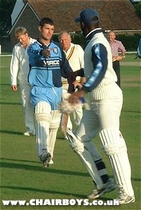 Jason Cousins and Steve Brown shake hands at the end of the cricket match