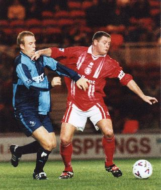 Paul Emblen scored his first goal for Wycombe in the game with Wigan. Here he is in action against that fat bloke earlier in the season - Picture with kind permission of Paul Dennis - Tel 01622-735143 - Do not republish without prior arrangement