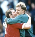 Martin Taylor celebrates with Macca - picture Paul Dennis